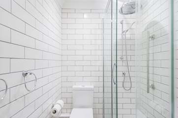 Bright white metro tiles in the shower rooms.
