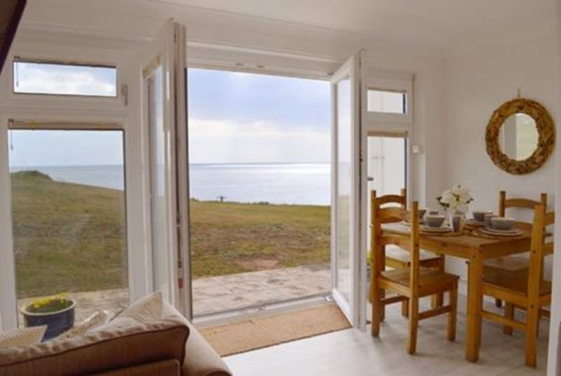 Open up the patio doors and walk out onto the grass to admire that uninterrupted view.