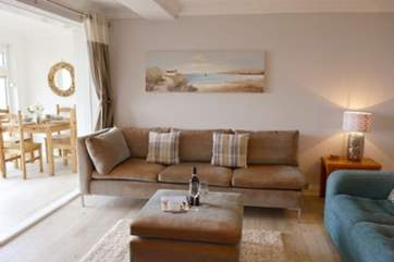 The beautiful living area has comfortable sofas to snuggle up in the evening with your feet up.
