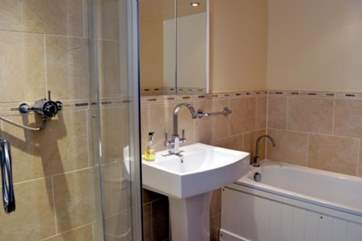 The family bathroom with both bth and shower cubicle