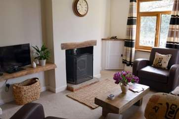 The sitting-room has a wood-burner to keep things nice and warm in the colder months