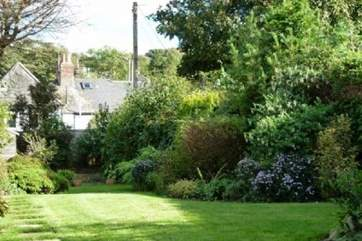 Fully enclosed garden to the rear of the house, mainly lawned perfect for children to let off steam