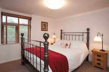 The second bedroom offers a lovely and comfortable room to relax in