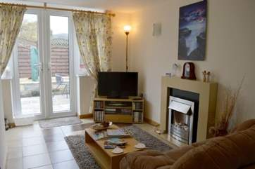If the sun isn't shining, keep warm and toasty infront of the electric fire in the living room