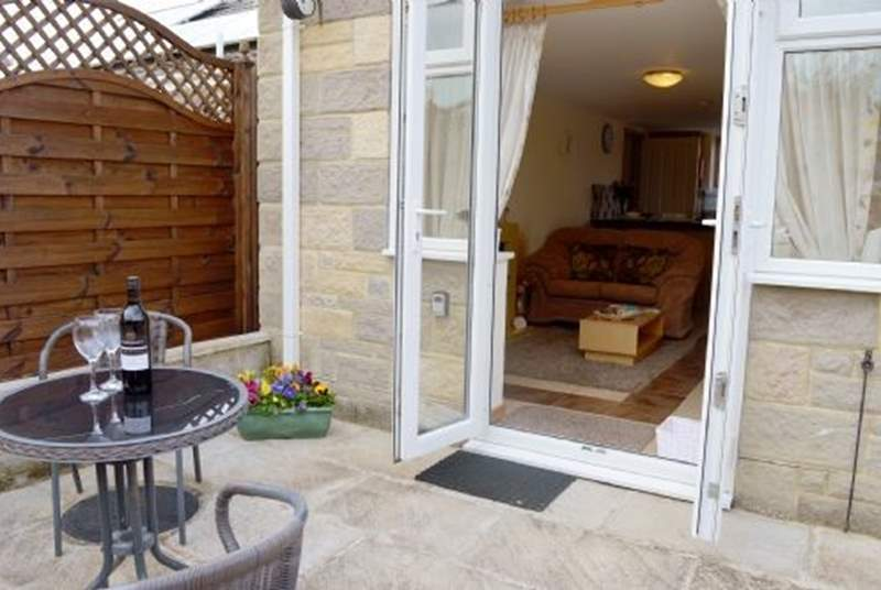 Patio doors lead from the sitting room into the rear garden