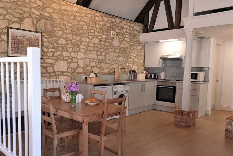 The open plan kitchen and dining area has a newly fitted kitchen
