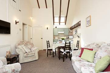 with high ceilings and beams the kitchen has a lovely country feel