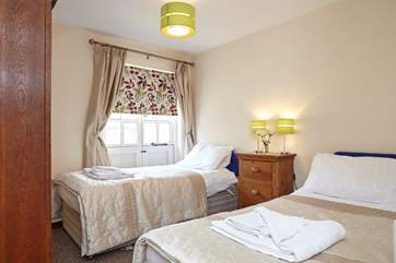 The lovely twin bedroom is great for adults or children alike