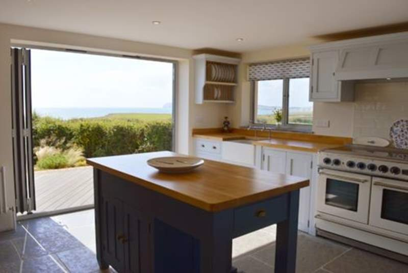 Open up the bi fold doors onto the decked area outside and let the summer breeze come through