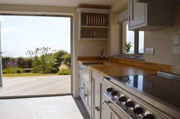A beautiful kitchen with doors out the the lovely garden, a delightful place to cook in