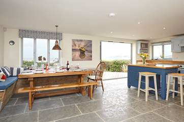 Open up the bi-fold doors, let the summer air in and enjoy a spot of lunch looking out across the sea