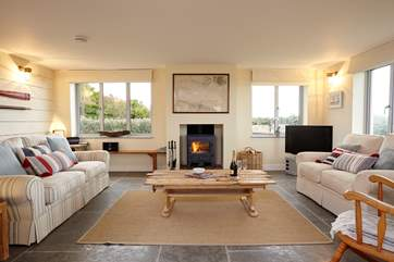 Light the fire and relax in comfort in the stunning sitting room