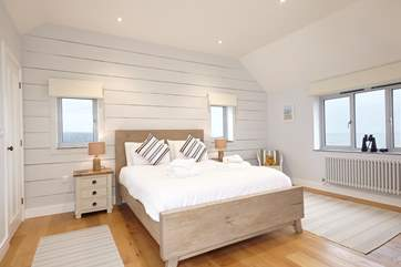 The lovely second double bedroom with stunning views across the water