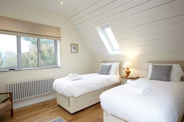 The light twin bedroom is a delight for children.