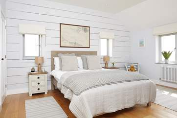 The lovely second double bedroom with views across the water.