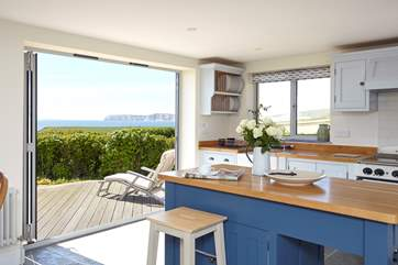 Open up the bi-fold doors, let the summer air in and enjoy a spot of lunch looking out across the sea, looking out to the white cliffs of Freshwater