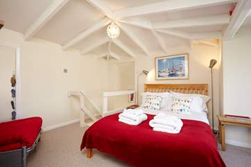 The master bedroom has vaulted ceilings and snuggle up in the arm chair to a good book