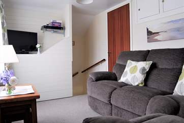 Sitting-room 2 has a Smart TV and  DVD player, with a door to Bedroom 2.