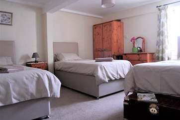 Three single divan beds in the ground floor bedroom.
