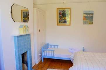 In the twin bedroom is a cute little todler bed for the little ones