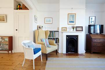 The main living room has an original ornamental fireplace, bringing charm and character to the room