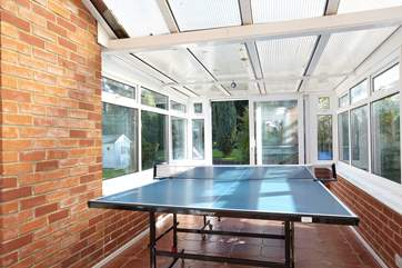 In the conservatory is a full-size table tennis table and games for the rainy days