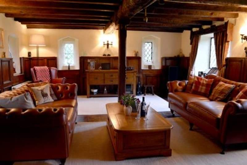 Stunning sitting-room with original character and features, including large feature inglenook fireplace.