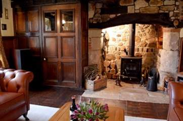 The sitting-room has beautiful original features, a lovely place to sit and relax.