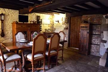 Gather around the large wooden dining-table for a yummy dinner and maybe a glass of wine too.