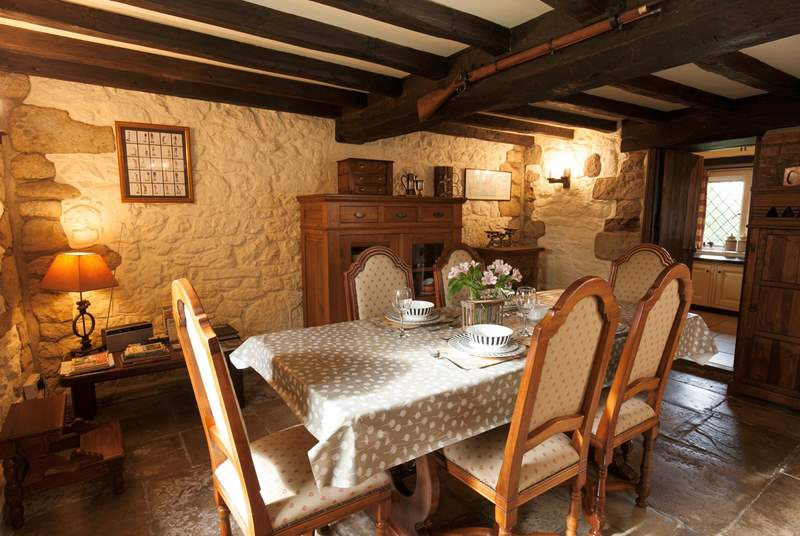The dining-room with original features and large wood-burning stove to keep everybody warm in the colder months.