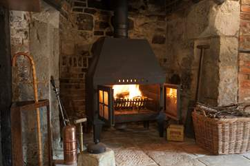 The log-burning stove in the sitting-room is sure to keep you warm and cosy on those colder days.