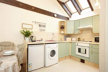 The kitchen has lovely high ceilings and wooden beams giving a lovely cottage feel throughout