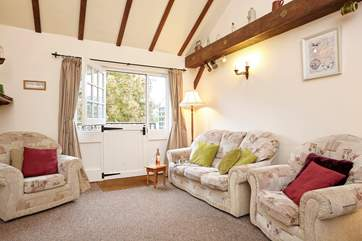 Cosy up on the sofa in the lovely sitting-room