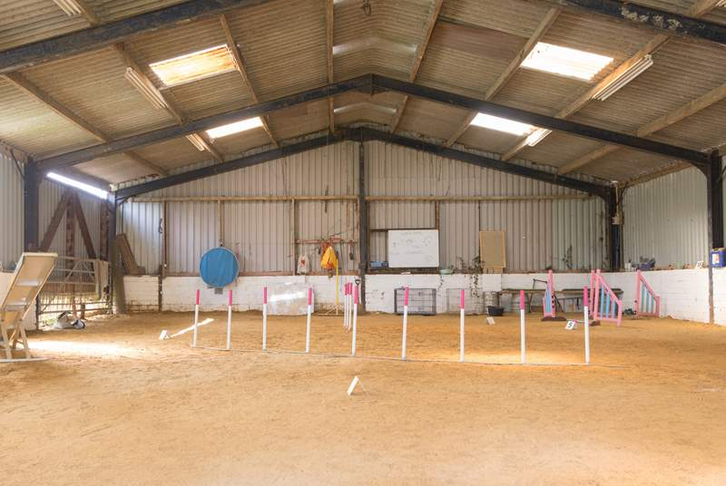 The nearby barn is used by the owners for dog agility training