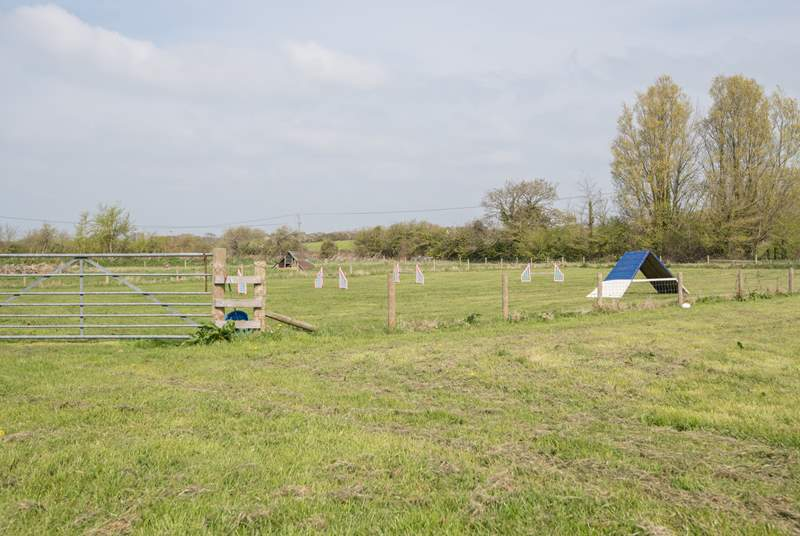 The fields at the rear lead into footpaths popular with walkers