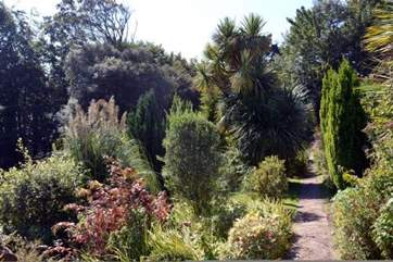 Surrounded by woodlands and attractive gardens.