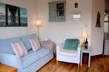 The living area is light and cosy to relax in.