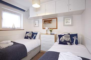 The nautical themed twin bedroom, is perfect for being right by the water