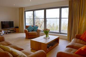 The extremely spacious living room with direct sea views is the place for relaxation