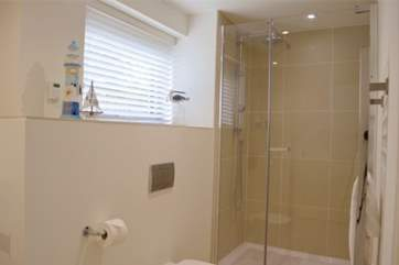 The en suite off the master bedroom with bath and separate shower cubicle