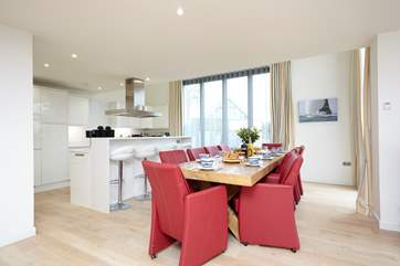 Gorgeous open plan kitchen and dining area with double-height bi-folding doors onto the external decking with panoramic Solent views