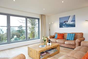 With floor to ceiling picture windows and patio doors, make the most of those great sea views