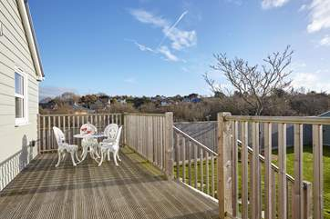 Relax on the decking within the calm and tranquill setting