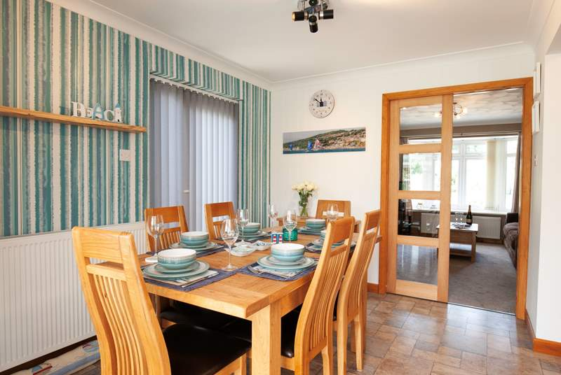 Boasting a sociable floorplan, the dining area leads out to a cosy sitting room.