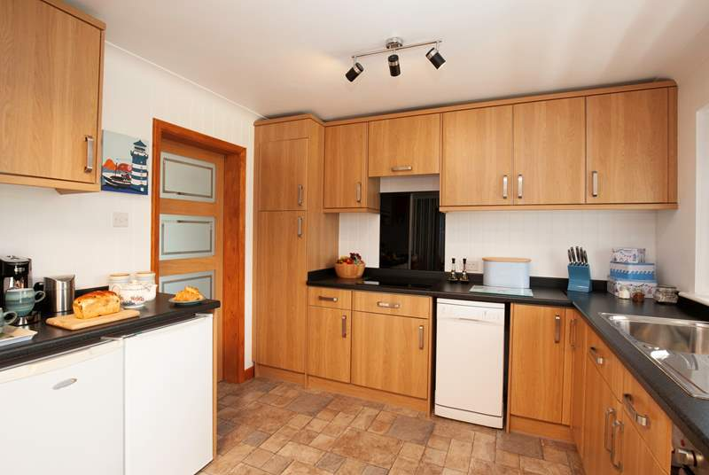 Modern and well-equipped, the kitchen offers ample cooking space.