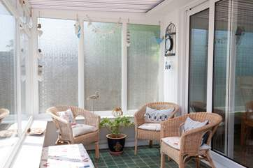 The conservatory is a lovely addition to this already spacious property.