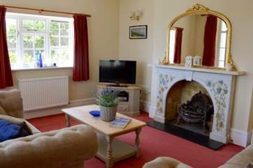 The cosy sitting-room with coal-effect gas fire.