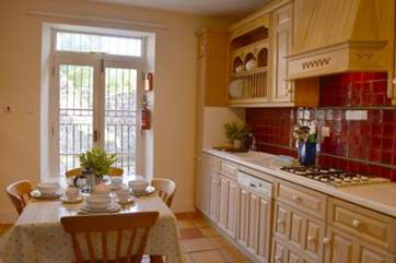 Traditional farmhouse style kitchen with breakfast area