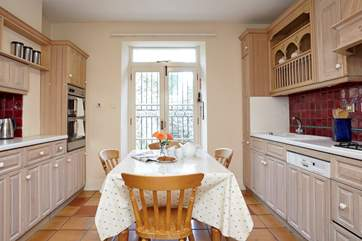 Traditional farmhouse style kitchen with breakfast area, well equipped with everything you will need