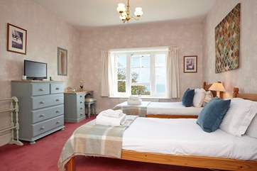 The twin bedroom is suitable for adults or children alike and has direct sea views through the window